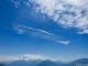 Nuage iridescent au dessus du Lac d'Annecy. Un nuage iridescent est un nuage peu épais dont l'écartement des gouttes ou de cristaux de glace provoque, par diffraction, une irisation de la lumière, qui donne alors cet aspect coloré au nuage (24 juin 2018)